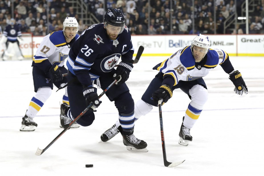 Blake Wheeler (26), des Jets de Winnipeg, et... (PHOTO JAMES CAREY LAUDER, ARCHIVES USA TODAY SPORTS)