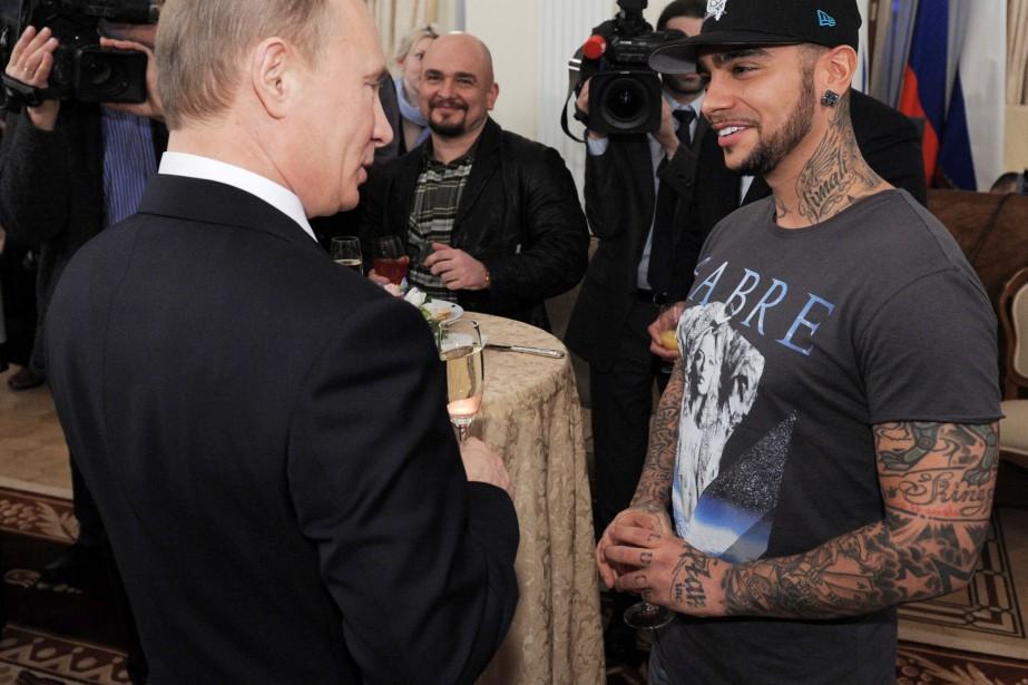 Vladimir Poutine lors d'une rencontre avec le rappeur... (PHOTO SPUTNIK PHOTO AGENCY, ARCHIVES REUTERS)