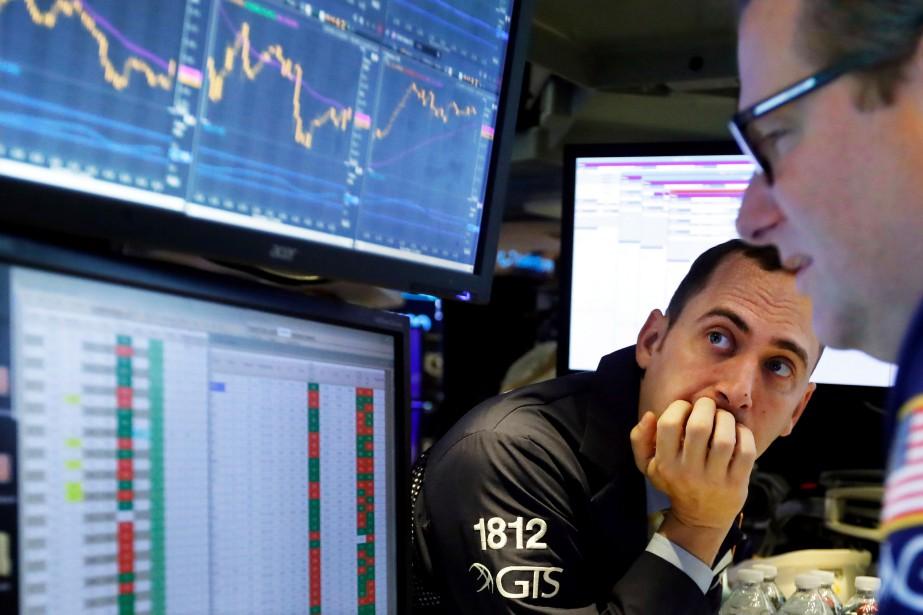 L'indice vedette de Wall Street, le Dow Jones... (PHOTO RICHARD DREW, ASSOCIATED PRESS)